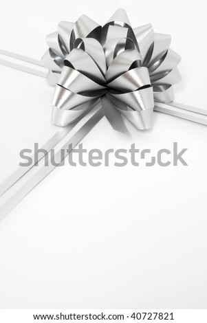 Big silver holiday cockade and strings on white background