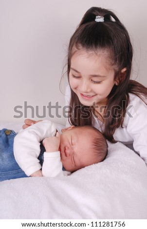 big sister and baby brother - stock photo