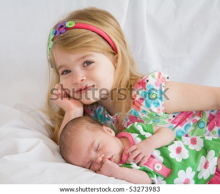 Big Sister with Newborn - stock photo