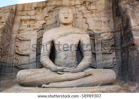 Big sitting Buddha and rock in Polonnaruva, Sri Lanka - stock photo