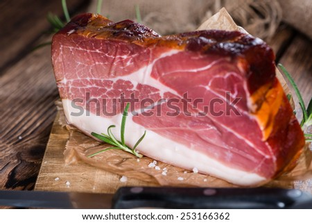 Big slice of smoked Ham (detailed close-up shot) with fresh herbs