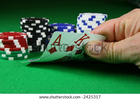 Big Slick - Ace King with poker chips on a green poker baize - stock photo