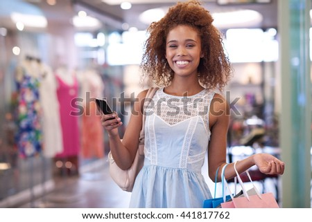 Big smiles at the shopping mall - stock photo