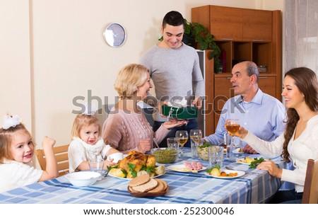 Big smiling family celebrating birthday at festive dinner - stock photo