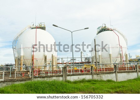Big sphere tank in chemical plant - stock photo