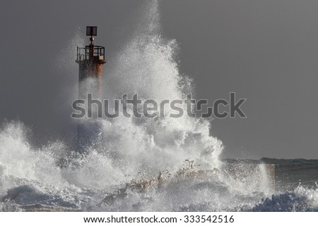 Big splashing wave closeup in a stormy evening. North of Portugal. - stock photo