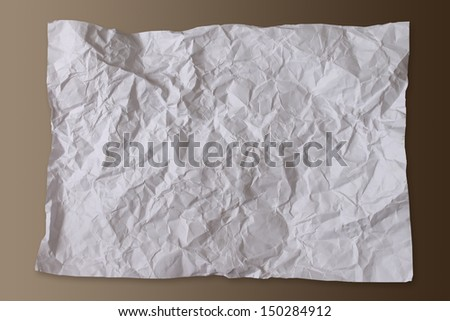 Big square crumpled paper on brown background.