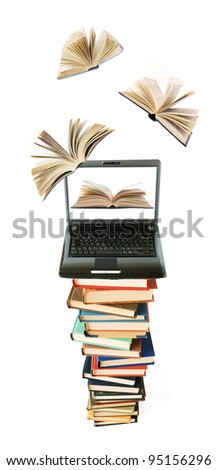 Big stack of books with opened laptop and books flying away (education concept)