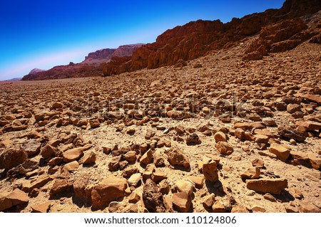 Big Stones in Sand Hills of Israel, Sunrise - stock photo