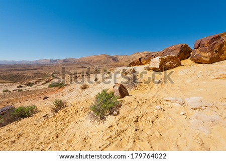 Big Stones of Grand Crater in Negev Desert, Israel - stock photo