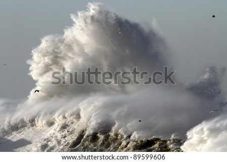 Big stormy wave against lighthouse in the north of Portugal near mouth of river Douro in Porto - stock photo