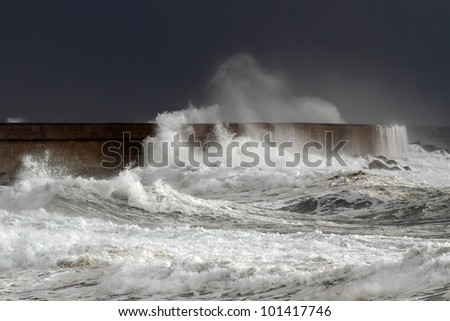 Big stormy waves crashing over Portuguese Coast - north wall of Leixoes harbor