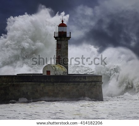 Big stormy waves over old lighthouse. River Douro mouth, Porto, Portugal. Enhanced sky. - stock photo