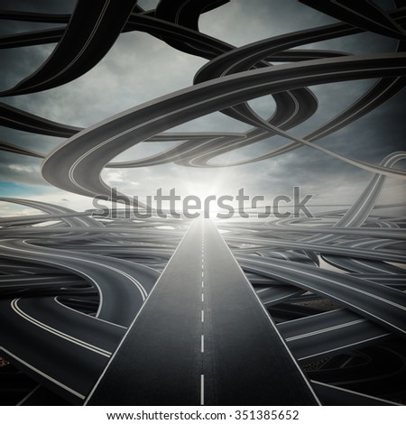 Big sunlit straight road on winding roads - stock photo