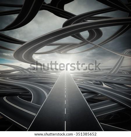 Big sunlit straight road on winding roads - stock photo