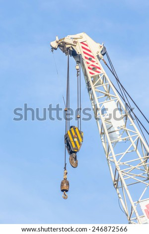 Big super construction crane for heavy lifting - stock photo