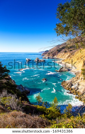 Big Sur is a sparsely populated region of the central California  Coastline along State Road 1 - stock photo