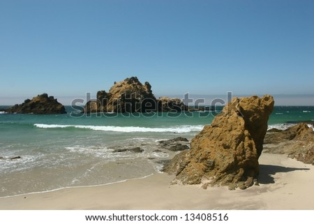 Big Sur is a sparsely populated region of the central California, United States coast where the Santa Lucia Mountains rise abruptly from the Pacific Ocean. - stock photo