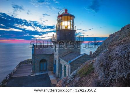 Big Sur.  Point Sur lighthouse at sunset. - stock photo