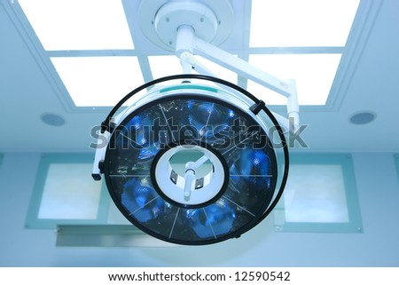 Big surgical lamp in operation theater - stock photo
