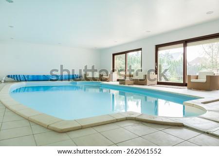 Big swimming pool in luxury residence - stock photo