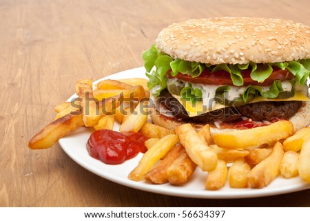big tasty cheeseburger with french fries - stock photo