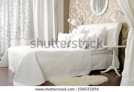 big the white double bed  in light  bedroom,  in hotel - stock photo