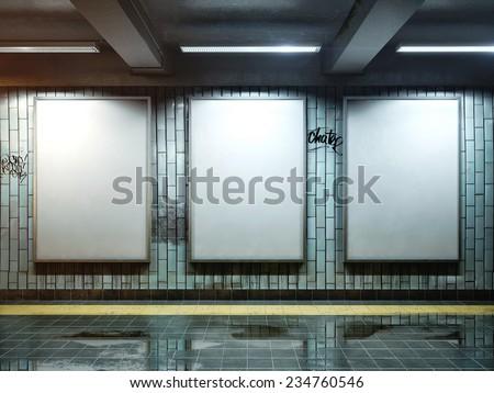big three vertical poster on metro station - stock photo