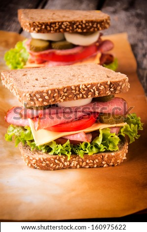 Big toast sandwiches with sausage and eggs  - stock photo