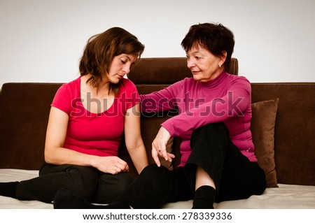 Big troubles - senior mother comforts daughter - stock photo