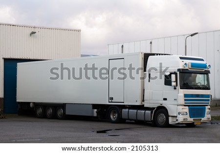 big truck at loading dock - stock photo