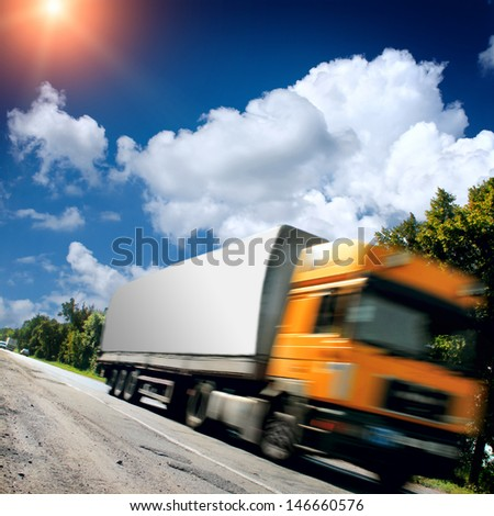 big truck on the asphalt road - stock photo