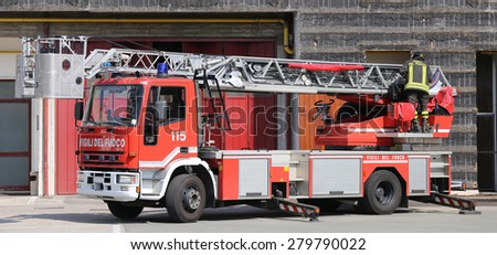 big truck with metal scale of firefighters in the Firehouse - stock photo