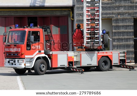 big truck with metal scale opened of firefighters in the Firehouse - stock photo