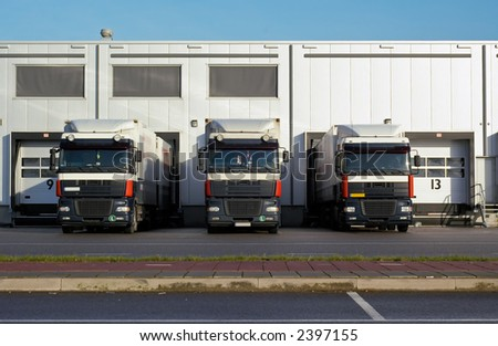 big trucks at loading dock - stock photo