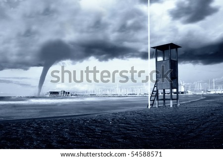 big twister arriving from the sea - stock photo