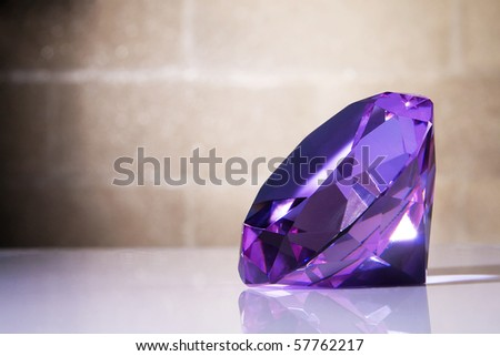 Big violet crystal against the brick wall background - stock photo