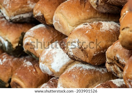 Big wall made of rye bread loafs - stock photo