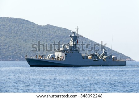 Big warship on a background of a hill