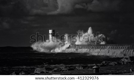 Big wave against pier and beacon of Douro river mouth, north of Portugal. Used infrared filter. Converted black and white. - stock photo
