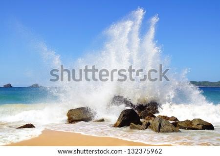 Big wave crashes on to the shore. Nacpan Beach. El Nido - stock photo