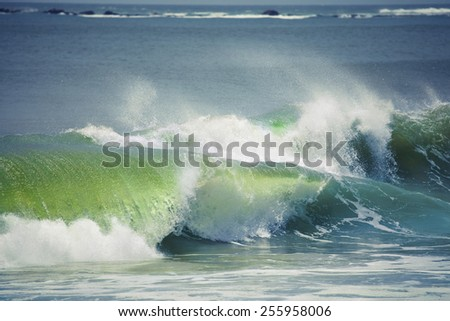 Big waves are rolling towards the shore - stock photo