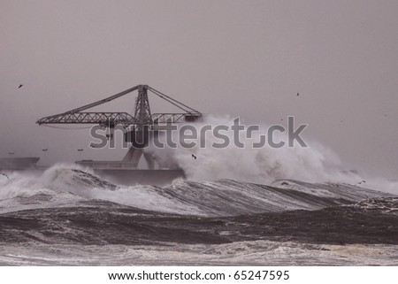 Big waves during a storm in the Portuguese coast - north side of Leixoes harbor - Porto - stock photo