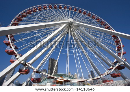 Big Wheel in Chicago, downtown buildings in the background. - stock photo