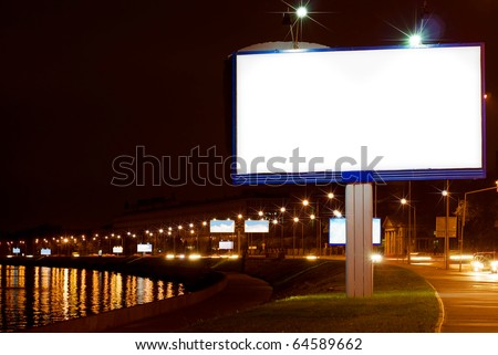 Big white billboard on night quay of Sankt-Peterburg - stock photo
