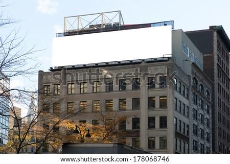 Big, white, blank, billboard on the grey building. Manhattan, New York. - stock photo