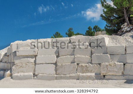 Big white blocks of raw marble in a quarry in Greece - stock photo