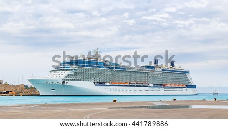 big white cruise ship in the port of the island of Rhodes Greece - stock photo
