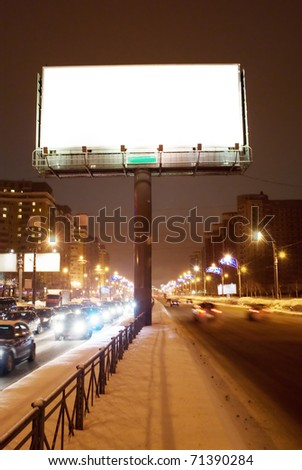 Big white empty billboard on the night street - stock photo