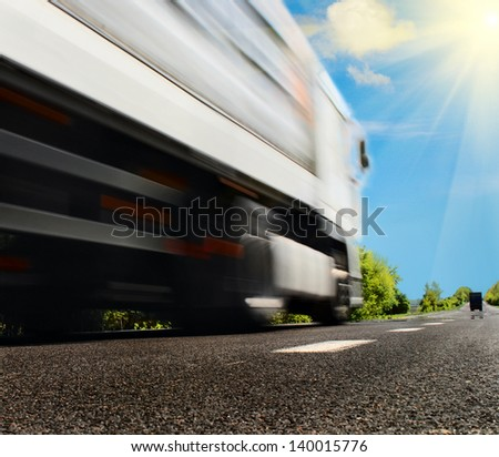 big white truck on the asphalt road - stock photo